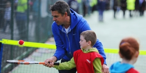 2011-MiniTennis_coaching-BrodiePark-600x300-getty